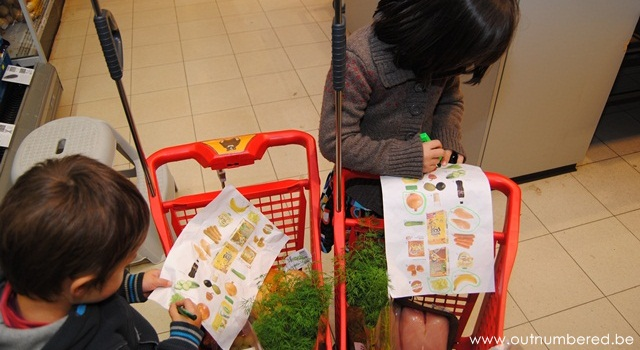 kids circle off items on their shopping list
