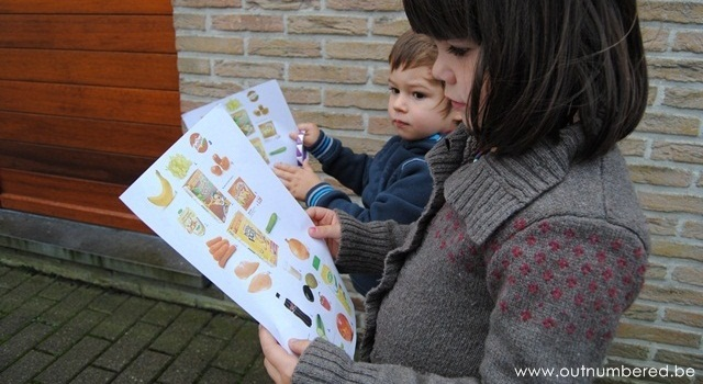 2 toddlers with their shopping list