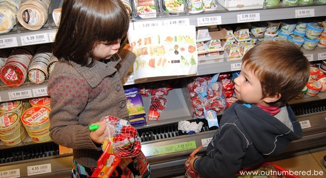 kids discuss what to buy at the supermarket