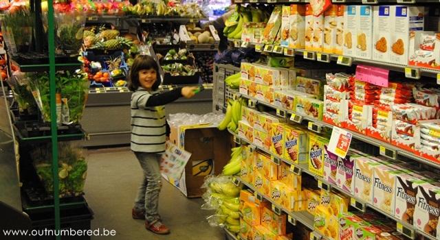 girl found bananas at the supermarket