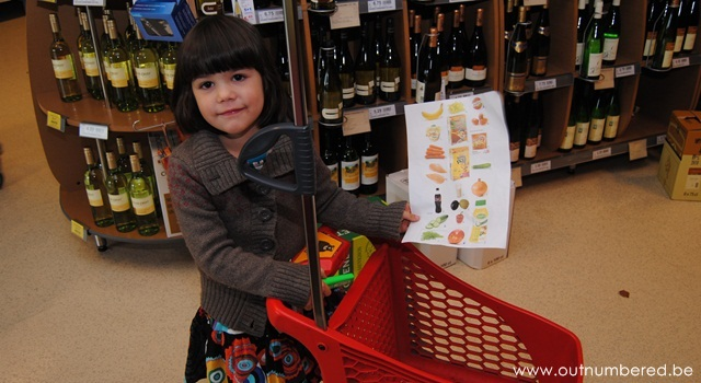 toddler with shopping list and cart